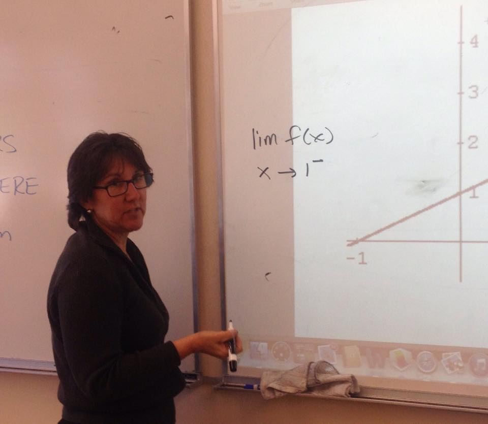 Bowers teaching an Introduction to Analysis and Calculus Class about limits. Bowers will replace Fung as Athletic Director next year, though she will still teach one math class.