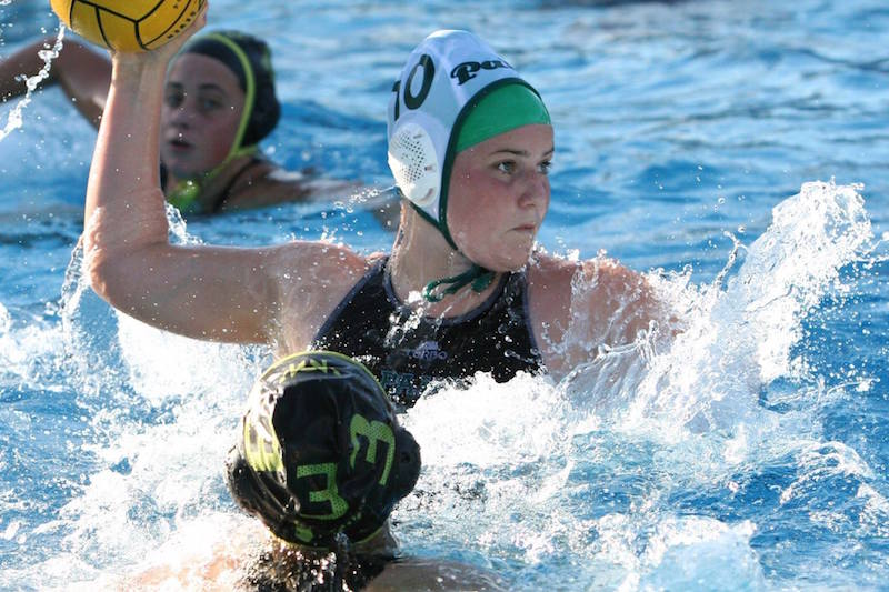 Freshman Sophie Frick looks to pass to a nearby teammate in a home water polo game against Mountain View. Frick began the season on JV and eventually moved up to varsity. Photo by Howard Look.