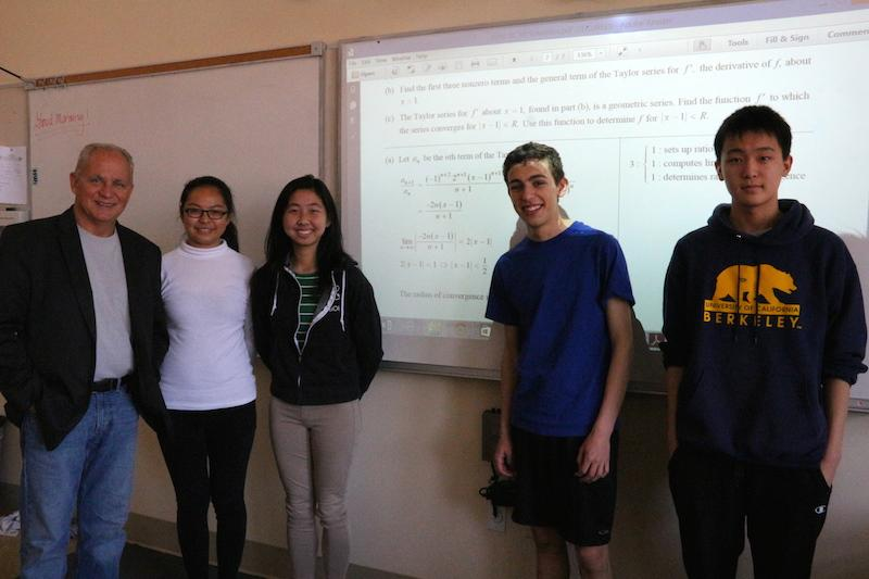 Palo Alto High School teacher Radu Toma and juniors Allison Zhang, Kathryn Li, Eric Foster and Andrew Lee (left to right) pose in their Advanced Placement Calculus BC class. The team wrote up its solution for the International Mathematical Modeling Challenge competition from April 19 to April 23. Contest results will be out in June. Photo by Lizzie Chun.
