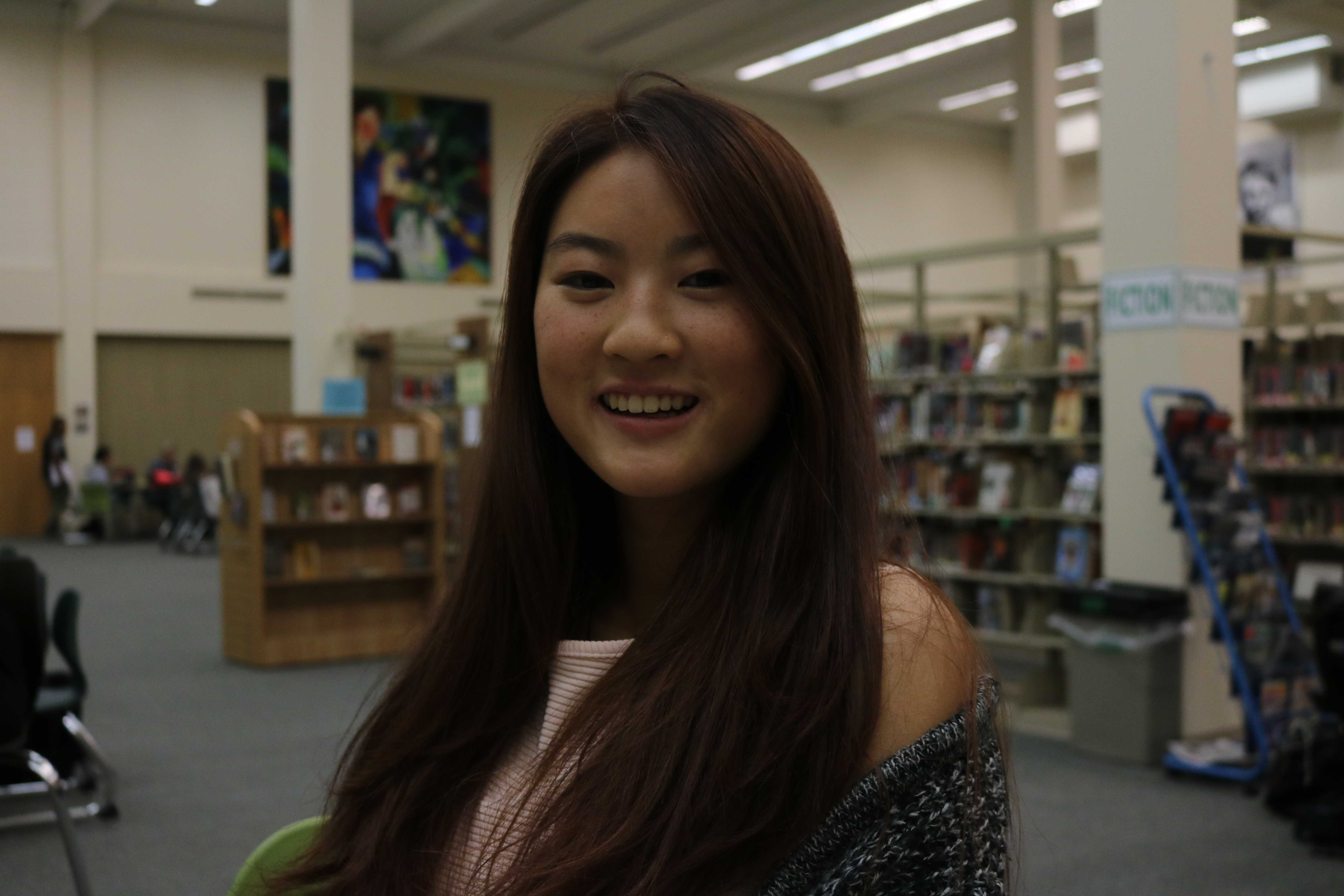 "Senior Karina Chan. ""You're really getting a bang for your buck,"" Chan said. ""It won't cost extra to get rid of a watermark or anything like that, so it [getting pictures taken by students] makes a lot of sense."" Photo by Emma van der Veen."
