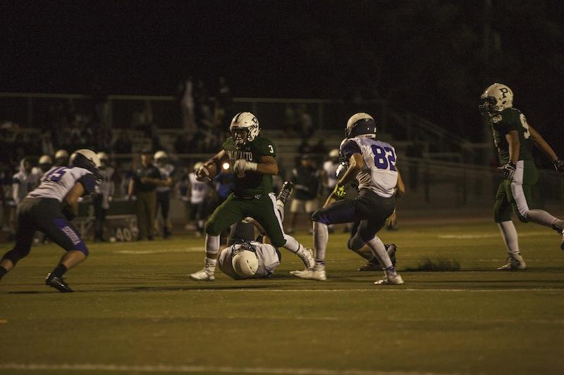 Senior running back Tony Caballero-Santana makes a cut upfield. Caballero-Santana rushed for a touchdown in the third quarter of Friday's game, as the Vikings defeated the Sequoia Cherokees 54-28. Photo by Cooper Lou.
