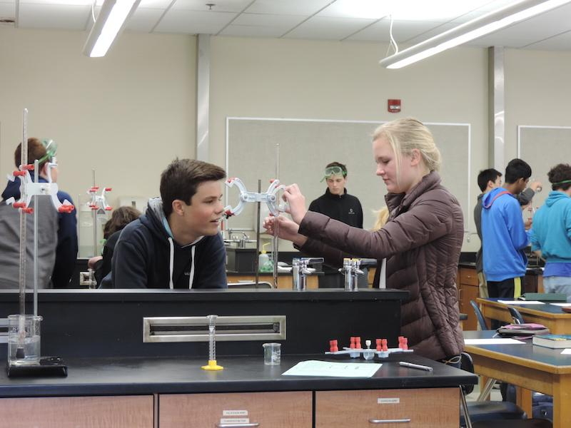 Juniors Johnny Rohrbach and Meredith Cummings conduct a science experiment. Advanced Authentic Research will provide students the ability to carry out experiments much like the ones in class, though they will be responsible for designing their own research. Photo by Adrienne Kwok.