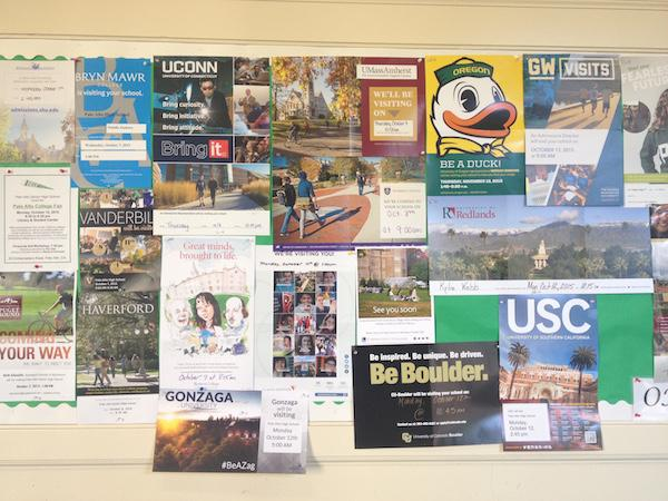 Visiting the College and Career Center in the administration building is a great way to keep updated on applications and attend college representative visits. This poster outside the center displays flyers from every college that visits Paly. Photo by Maya McNealis.