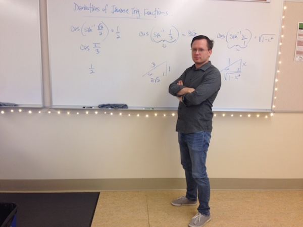 Math teacher Dave Peters presents the inverse trigonometry derivatives his BC Calculus students are learning. This is his first year teaching the BC Calculus lane, having previously taught AB Calculus. Photo by Ana Caklovic.