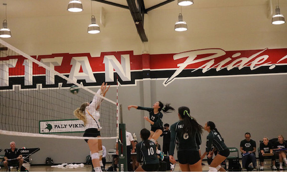 Outside hitter Chelsea Fan hits a ball by Mountain View blockers. Fan would go on to have 23 kills in the win against Mountain View. Photo by Victor Carlsson.