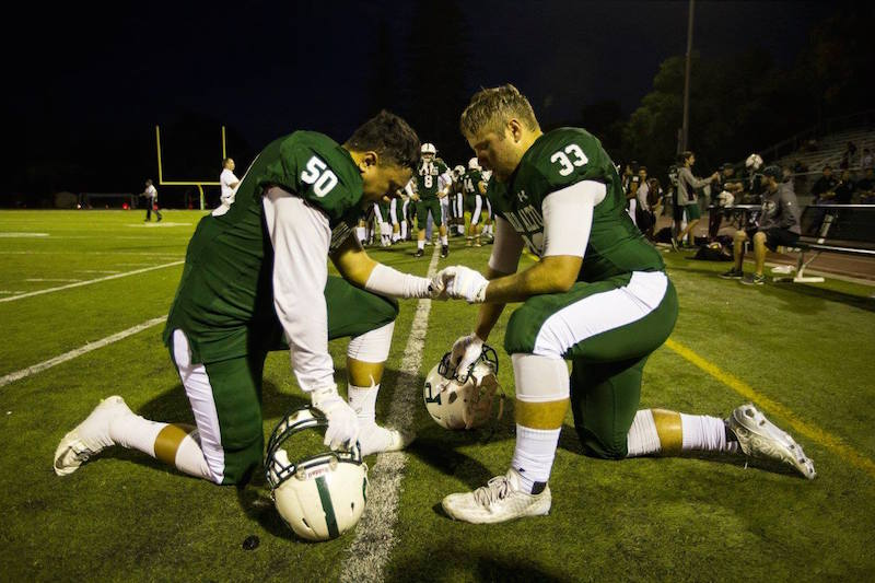 Members of the 2015 Palo Alto High School football team prepare for a regular season game. Photo by Cooper Lou.