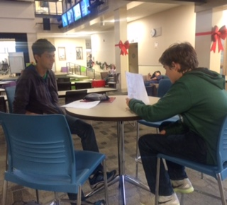 Sophomores Devin Ardeshna and Charlie Baldwin help each other study for their classes.