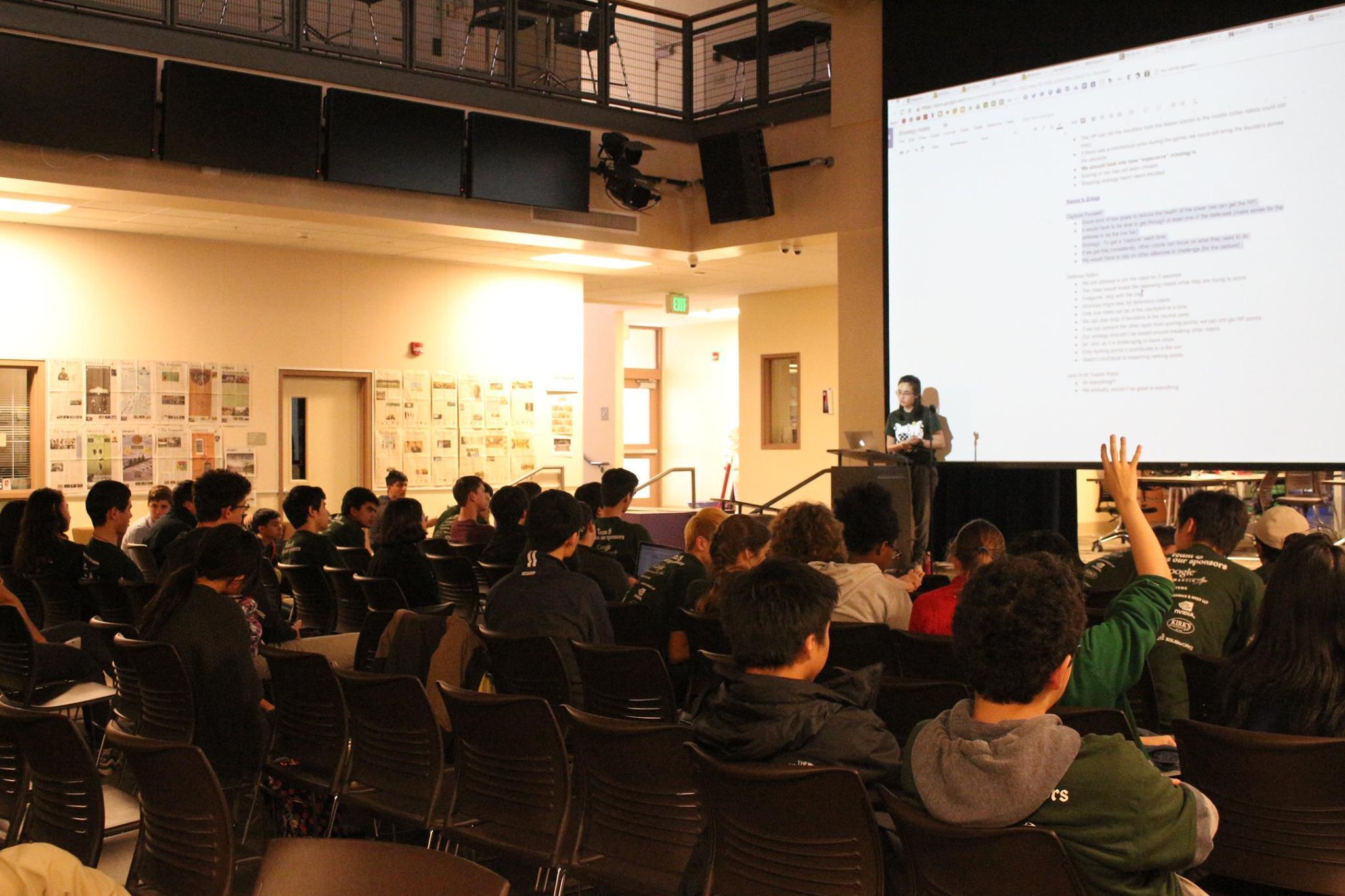 Senior and team captain Claire Kokontis leads the strategy meeting for the Palo Alto High School robotics team.