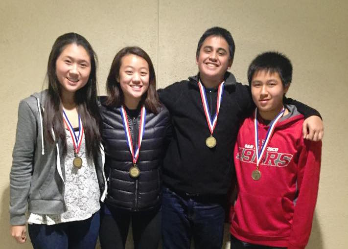 Sophomores Frances Zhuang and Tanay Krishna, junior Candace Wang, and freshman Leyton Ho celebrating with their awards after the LD tournament.