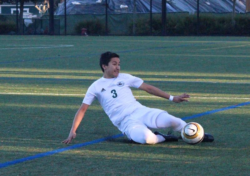 Senior outside defender Roberto Sotelo slides to keep the ball in bounds during the second half of the Vikings' game against Mountain View High School.