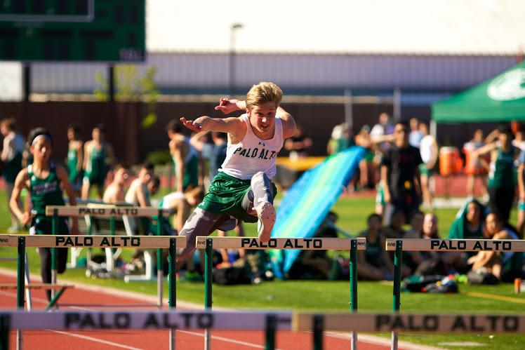 Sophomore Darby Felter competes in the 110 meter hurdles. Felter would go on to win this event as well as the 300-meter hurdles. The vikings' relied on Felter and other underclassmen to fill the shoes of runners who had left due to a band trip. Photo by Cooper Lou