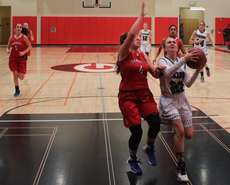Senior guard Maddy Atwater drives to the basket against Saratoga in a regular season matchup on Feb. 2 at Gunn High School. Photo by Sam Lee.