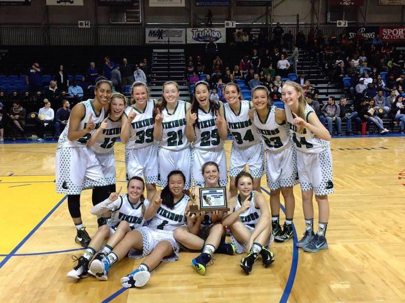 The Palo Alto High School girls' basketball team poses for a photo with its championship medals after defeating North Salinas High School in the CCS finals. Senior center Alexis Harris led the game in rebounds with 27 boards. Photo by Sam Lee.
