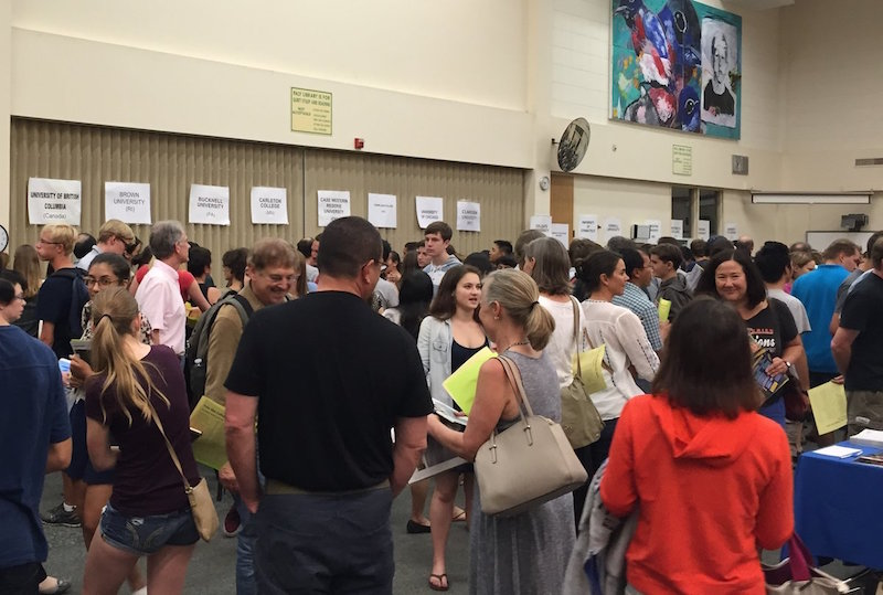 Parents and students visit the Palo Alto Unified School District annual College Fair at Palo Alto High School to receive information on various schools. Photo by Ethan Kao.