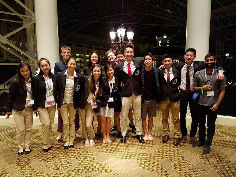 Palo Alto High School and Gunn High School students pose together at the International DECA competition in Nashville, Tenn. Four of the six Paly students pictured above were the first to ever qualify for the competition. Students from left to right: Hannah Pan (Paly), Allison Wu (Paly), ---, Stephanie Cong (Paly),