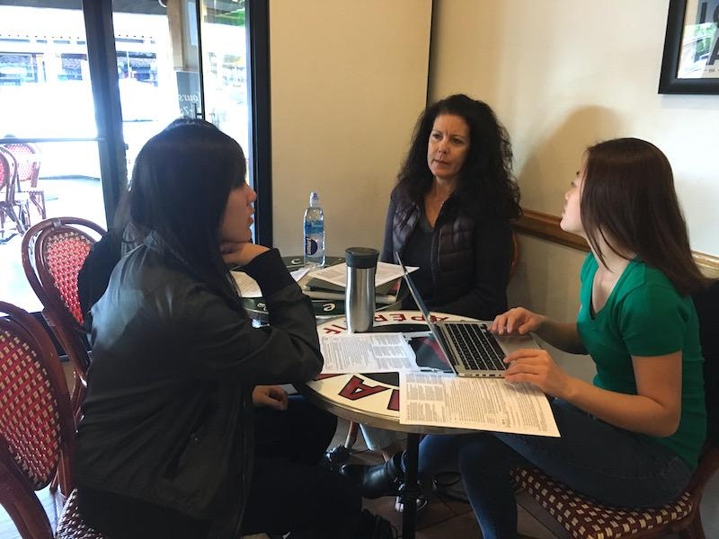"Juniors Candace Wang, and Vivian Wu collaborate with Christina Owen during a Get Involved Palo Alto meeting. """"Photo by Daniella Maydan"