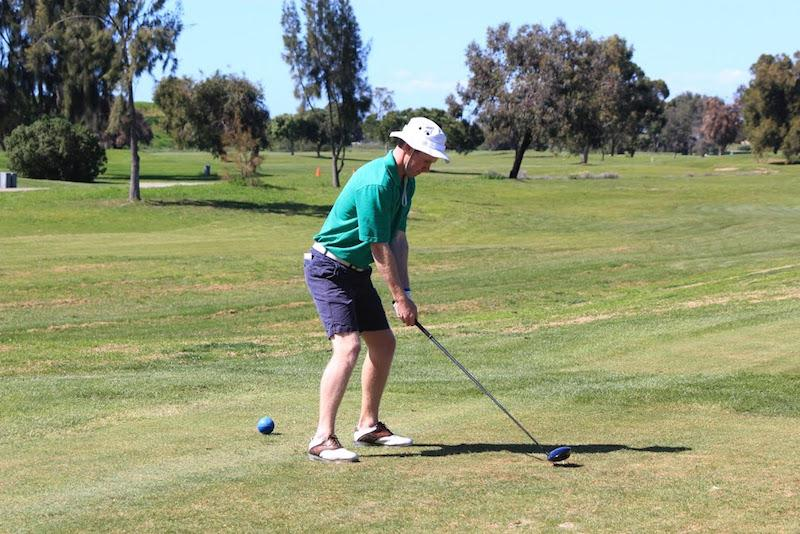 Senior captain Henry Gordon tees off in a match early in the season against Los Altos High School. Gordon will play golf next year at Occidental College. Photo by Cooper Lou.