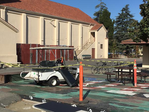 "A stolen Stanford golf cart is sitting on the Palo Alto High School senior deck. According to assistant principal Jerry Berkson the cart was stolen last night, and was left on the deck because it was not workable. ""They pulled some of the wiring from the batteries,"" Berkson said. Photo: William Sallomi"