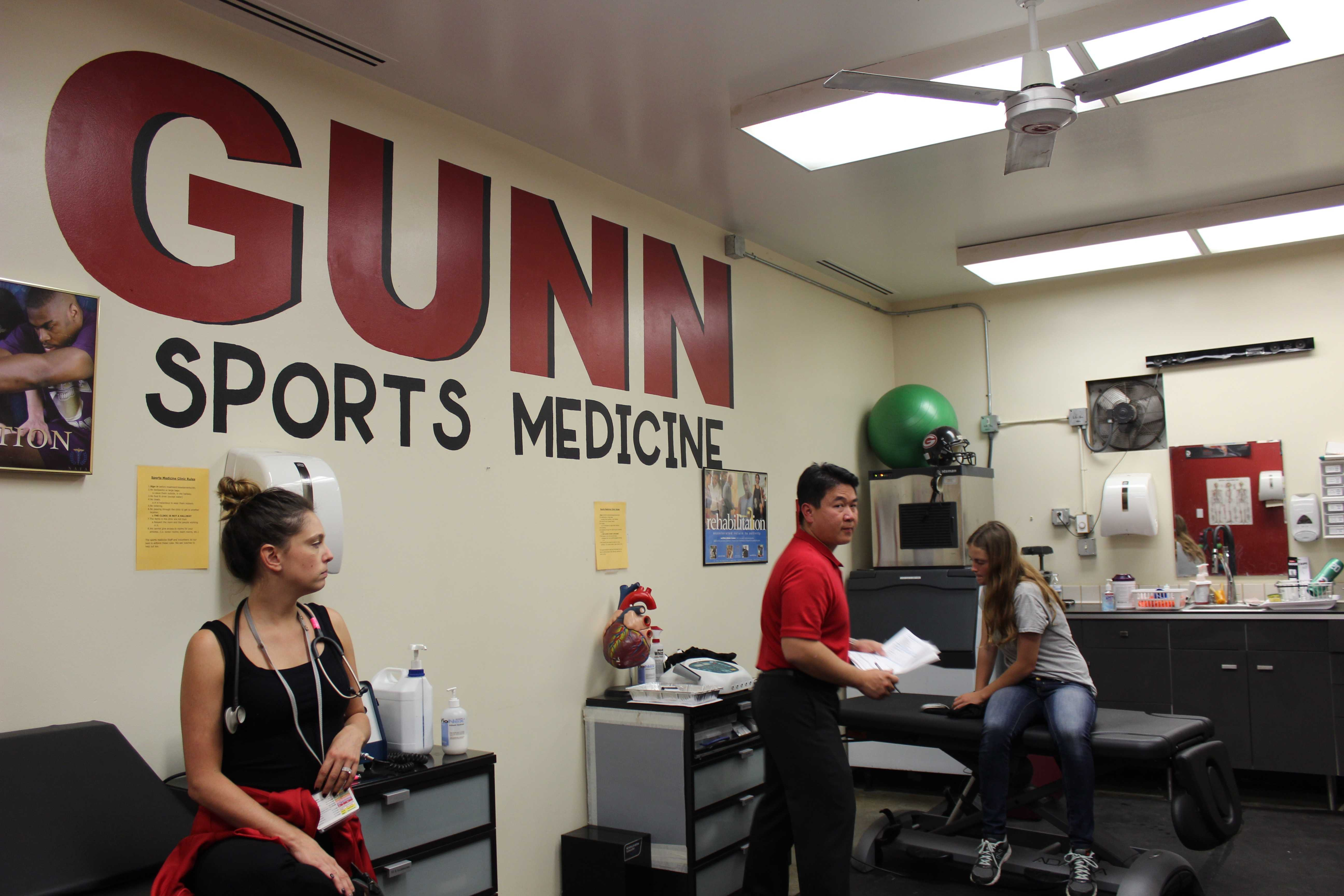 Stanford Physicians hold one-on-one conferences with student athletes as a final assessment of their health for sports physicals. Photo by Bianca Al-Shamari