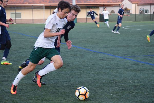 Sophomore Jason Shorin chases after the ball