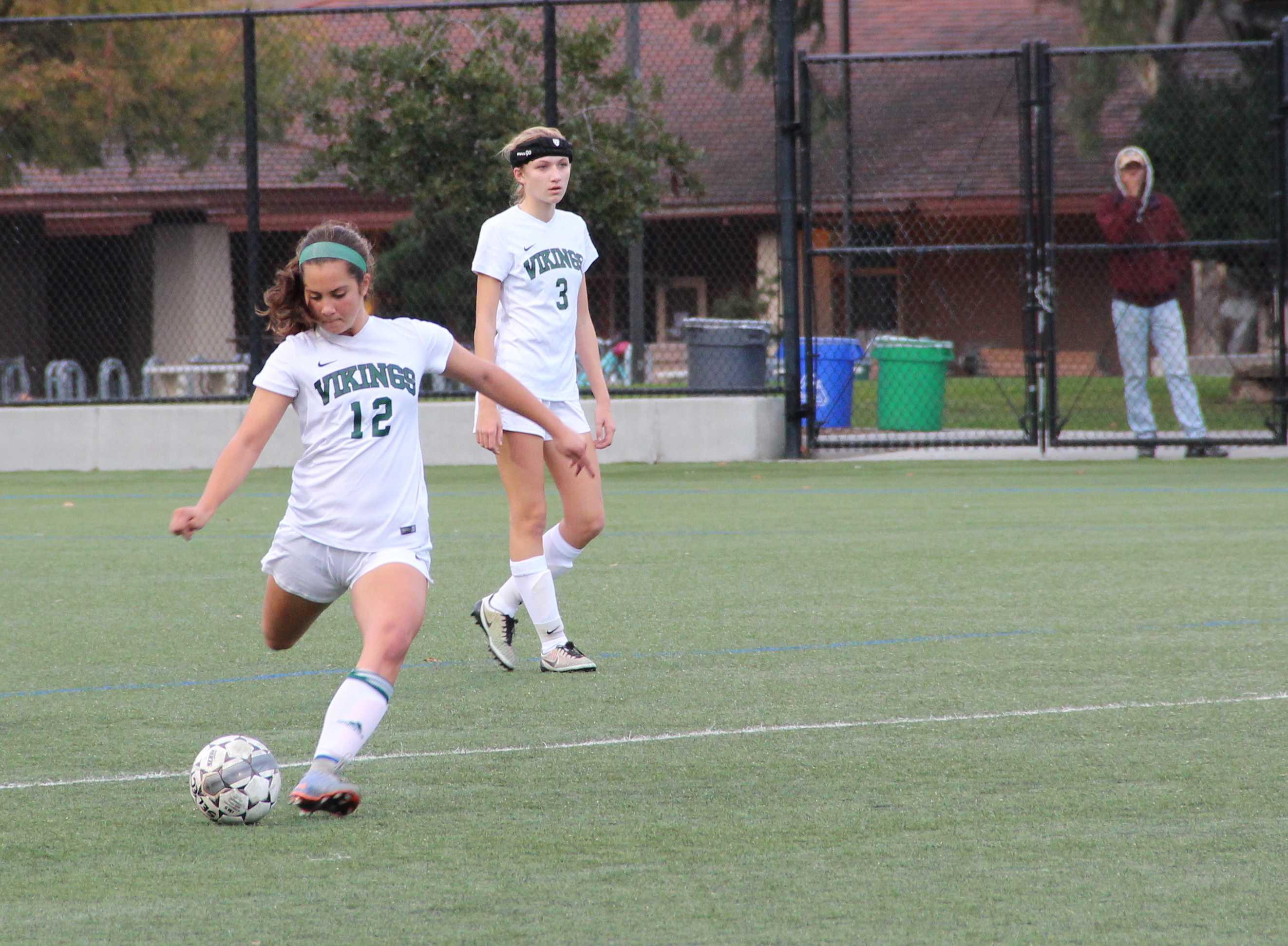 Senior midfielder Talia Malchin passes the ball upfield against Gunn in December. Photo by Rachel Code.