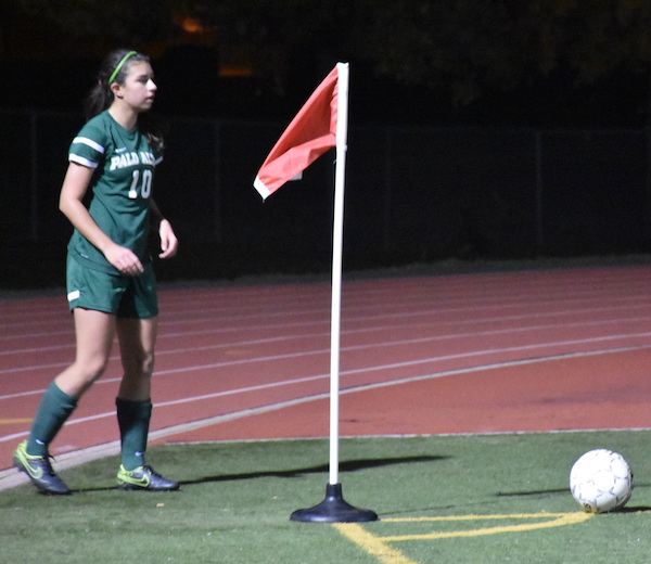 Junior midfielder gets ready to take a corner kick against Gunn last Thursday during the second half of an away preseason match. Senior Tess Preising converted the goal off Tomz' cross. Photo by Rachel Code.
