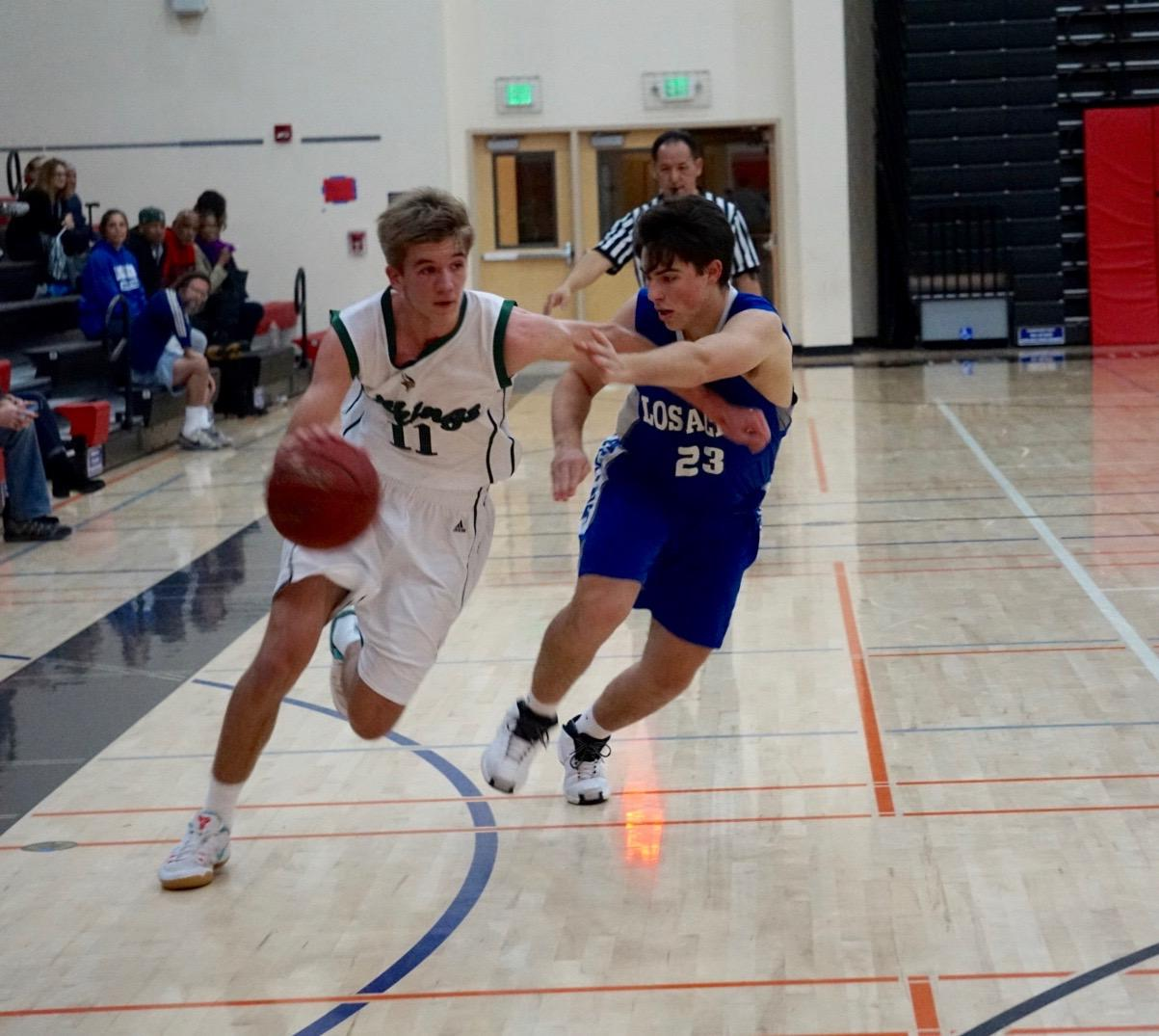 Junior forward Max Dorward drives past a Los Altos High School defender. Dorward has carried the Vikings to a strong, 4-0 start, in De Anza League play. Photo: Benner Mullin.