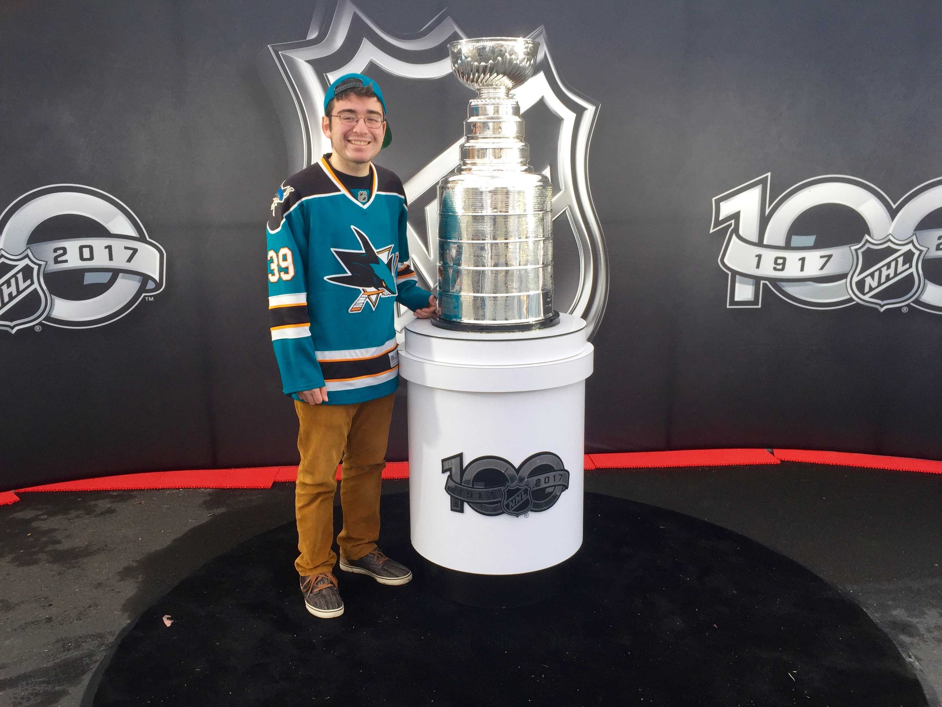 Junior Bradley Smith poses in front of the one and only Lord Stanley's Cup, given to the champion of the NHL
