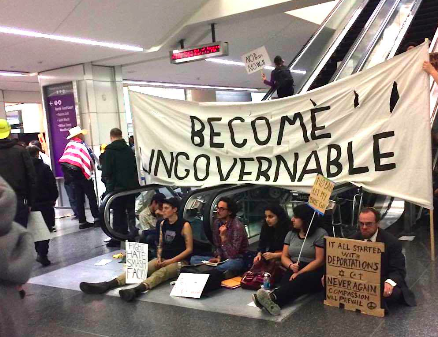 Locals gather at SFO in an effort to pressure officials to release five detainees as a result of Trump's recent travel restrictions. Photo by Harrison Frahn.