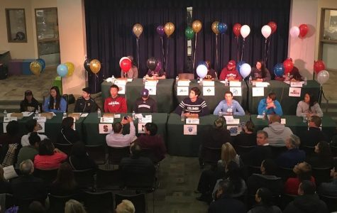 15 senior athletes commit to schools on National Signing Day