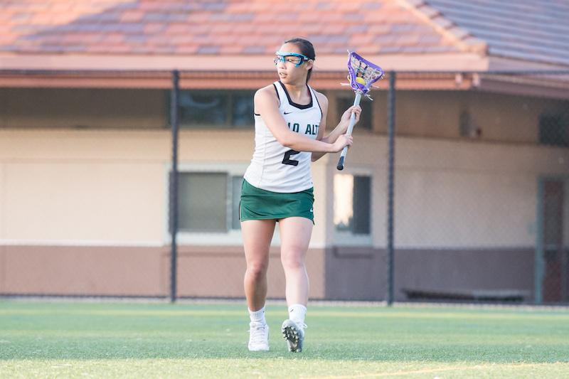Senior captain Kaitlin Chiu surveys the field for an open teammate in the first half of the game against Los Gatos High school on April 14 at home. The Vikings lost in overtime 7-6.