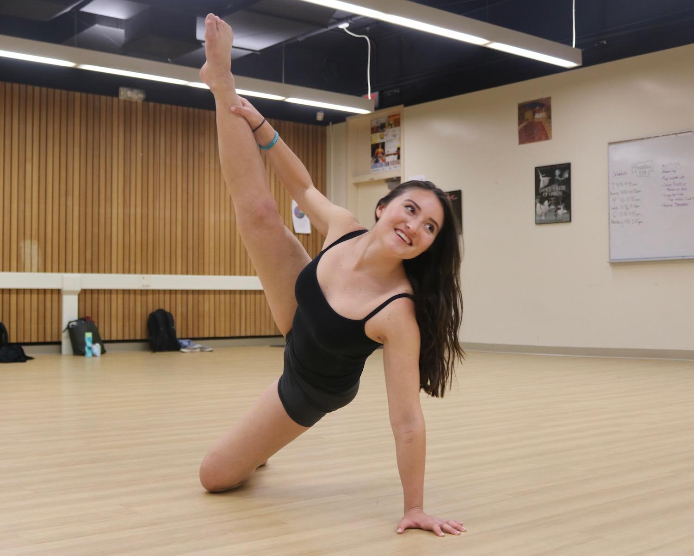 Senior captain Nathalia Castillo dances in preparation for tomorrow's Paly dance team showcase. Photo: Emma van der Veen.