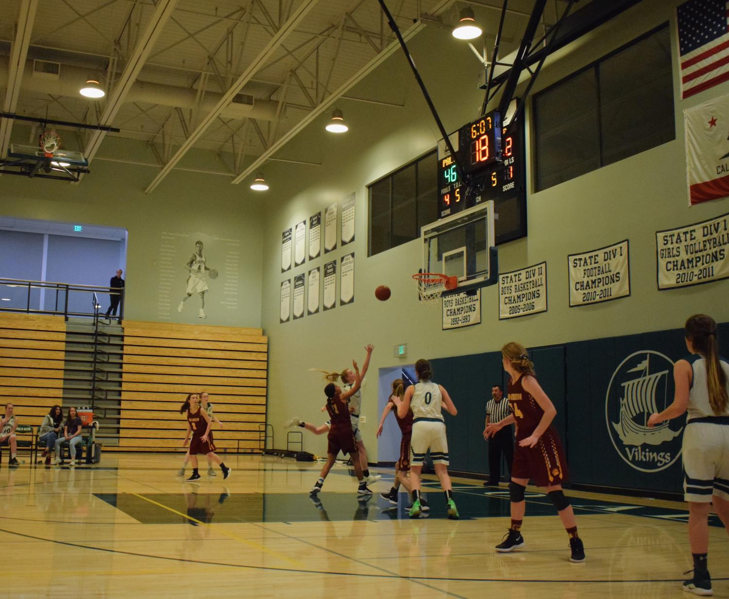 Senior Ellie Jeffries goes in for a shot during the Feb. 21 game against Menlo-Atherton Photo: Gracia Hmelar