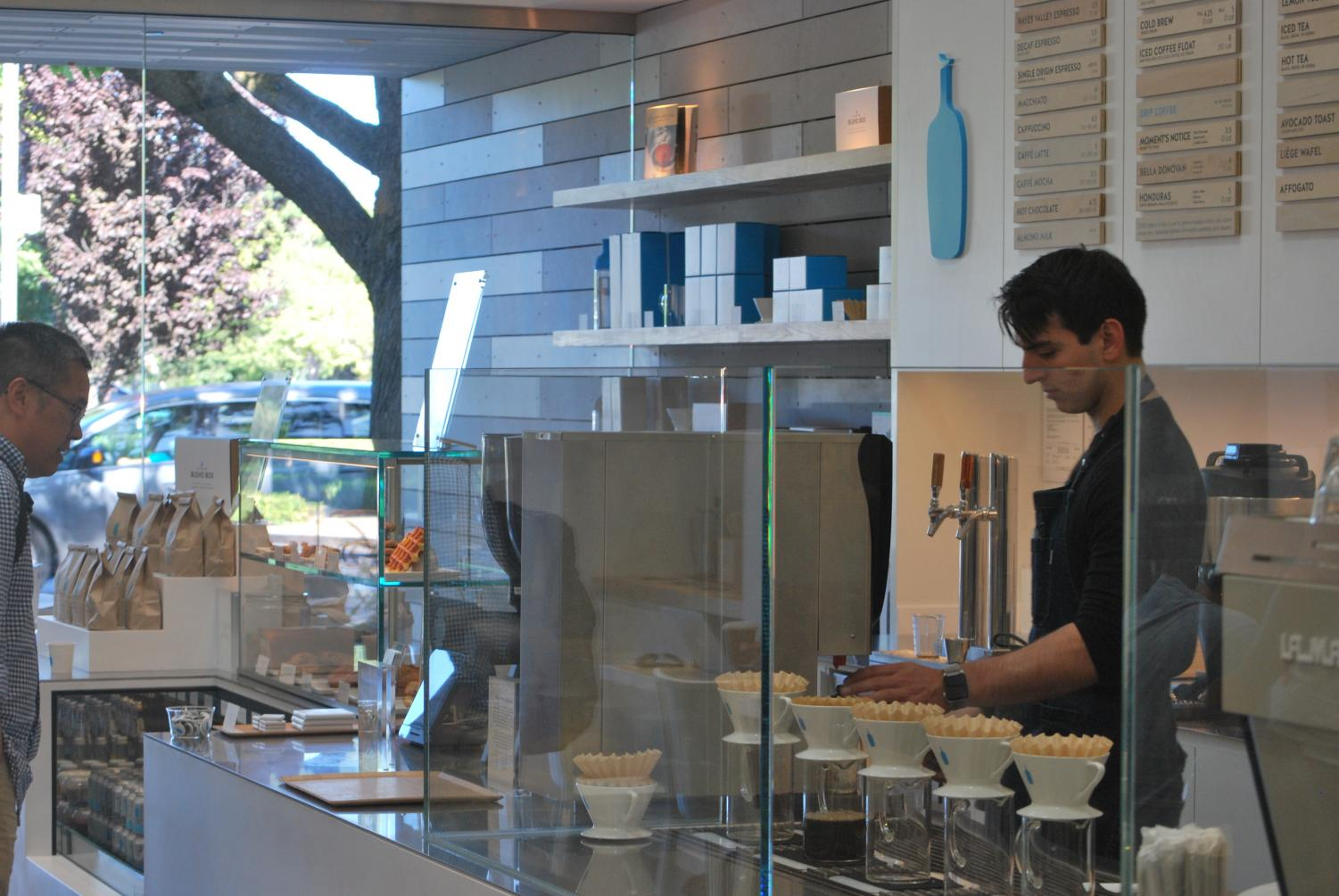 """A customer waits to order at the recently opened Blue Bottle Coffee shop at Stanford Shopping Center. Customer Gabbi Irwin says she thinks the location is convenient and plans to come frequently. """"I really like the atmosphere of the place,"""" Irwin said. """"It's really nice."""" Photo: Hallie Faust"""