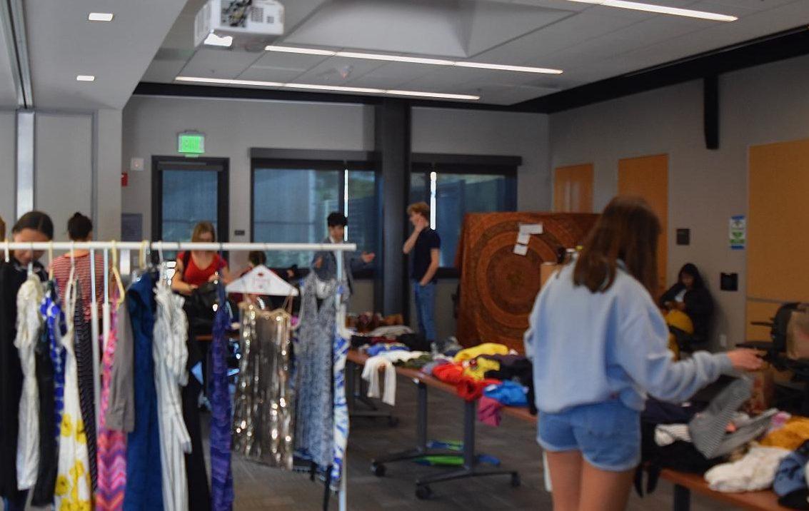Teens trade clothing items at the Teen Arts Council Clothing Swap, Saturday.