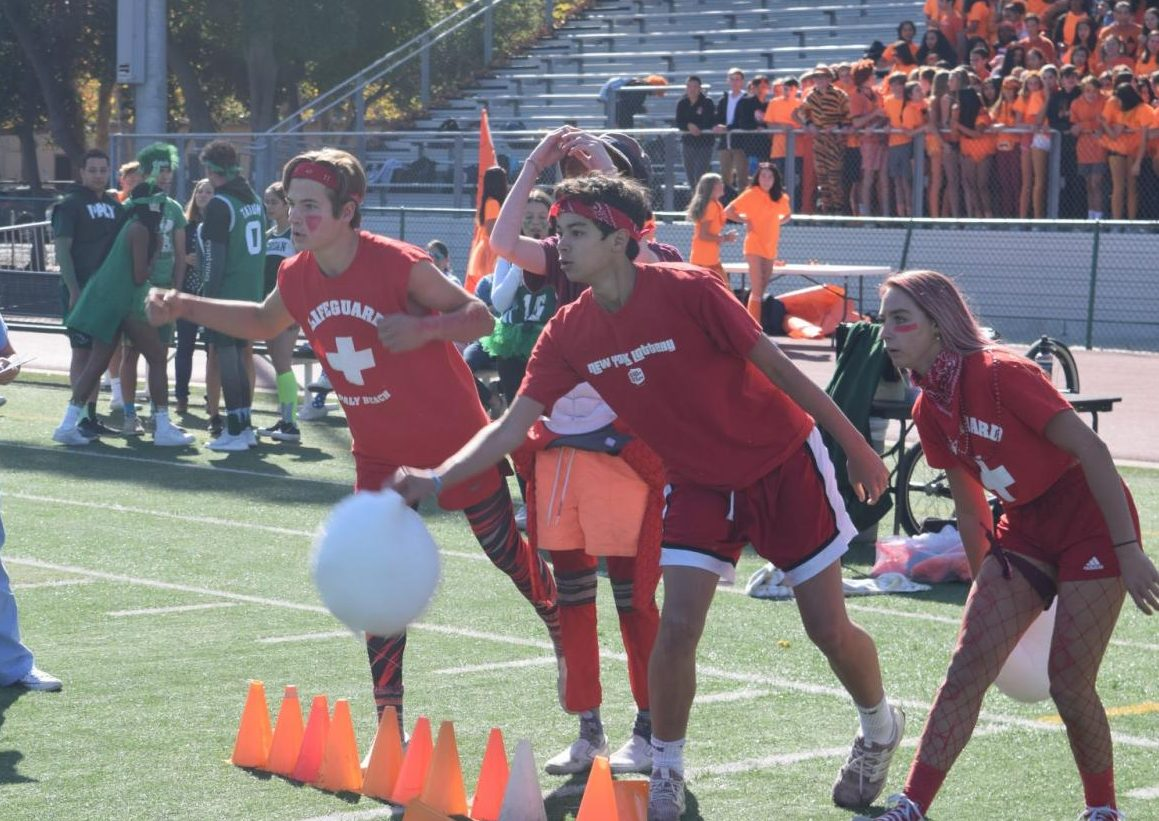"""Four students from the class of 2022 participated in a super-sized game of corn hole during the lunch rally Wednesday at the Palo Alto High School Viking Stadium. The sophomores earned first place in corn hole, but remain in third place overall. """"We were louder than we were last year, which is awesome,"""" sophomore Owen Rice said. """"[Our] cheers are better."""" Photo: Sophia Krugler"""