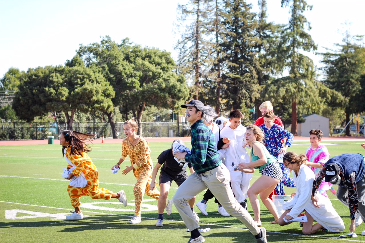Freshmen and seniors armed with socks run to throw them during Clean Your Room. The freshmen-senior team won the game, earning them 1,500 points. Photo: Margaret Li