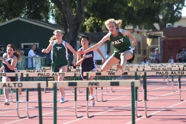 Junior AnaCena Zander wins in a hurdle event, winning five points and leading the girls' varsity to a victory over visiting Lynbrook High School. Photo by: David Lim