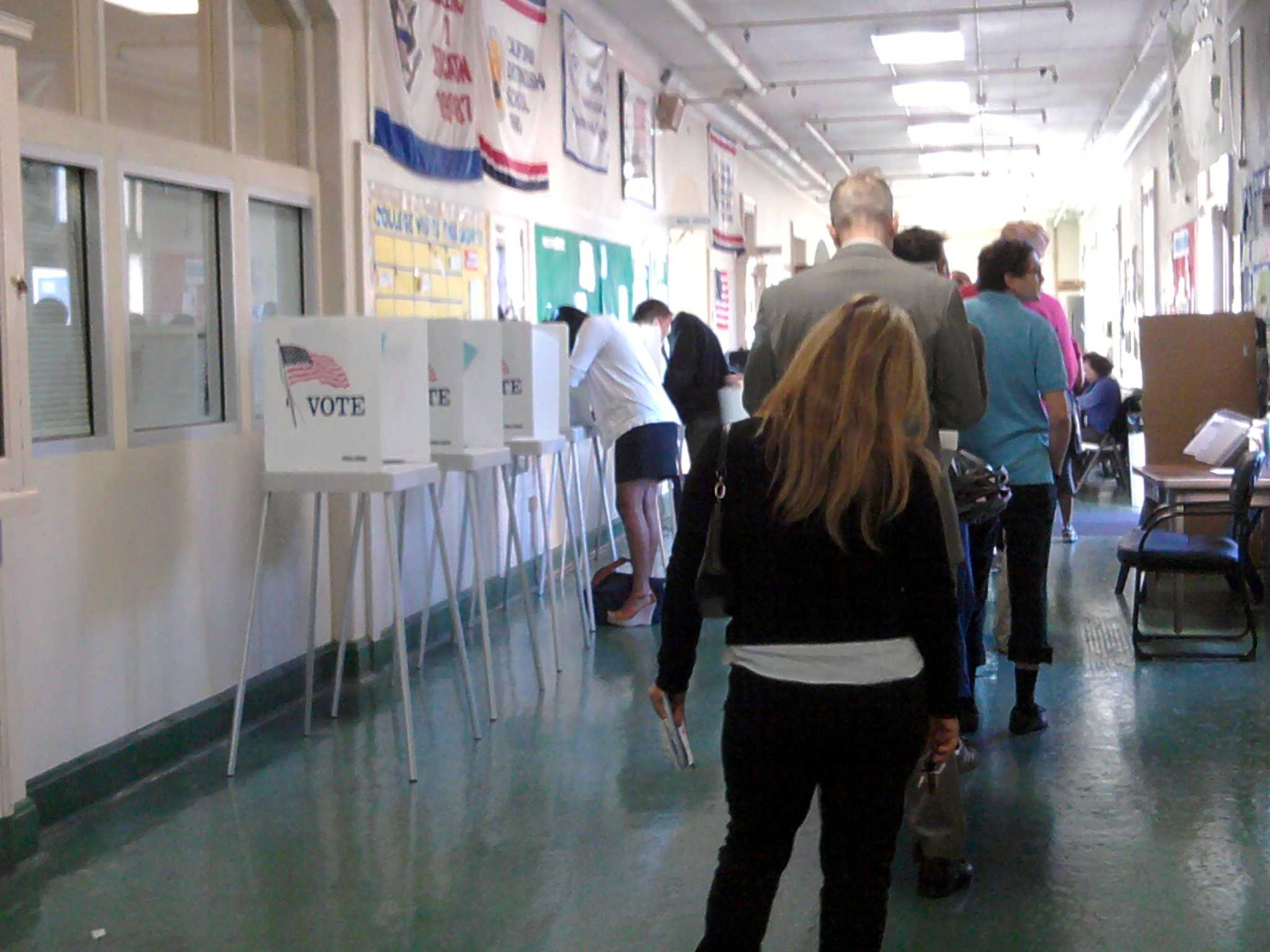 Voters wait in line inside Palo Alto High School's Tower Building to cast their vote. Photo by Phoebe So.