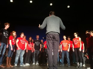 """Choir teacher Michael Najar conducts the Madrigals in their rendition of The Beatles' """"While My Guitar Gently Weeps."""" Photo by Paige Esterly."""