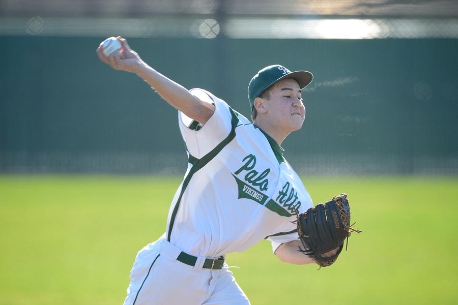 Starting pitcher Chris Smith throws a fastball in the first inning of Paly's 9-3 season opener loss to St. Ignatius last year.  Photo by Matt Ersted.
