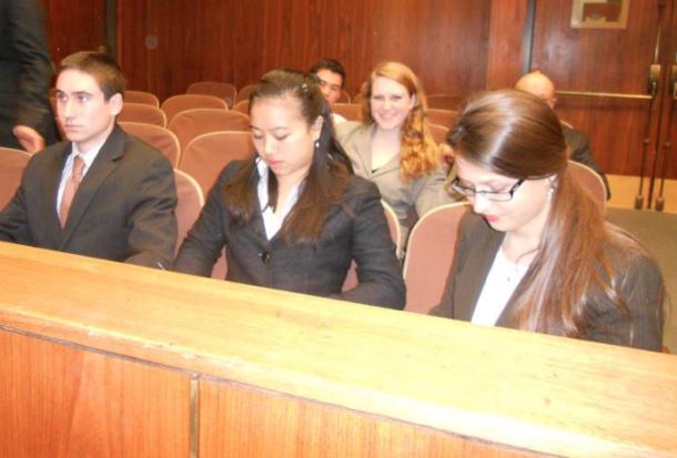 Mock trial team members Charlie Dulik, Jessica Tam and Sophia Sholtz prepare for a trial.