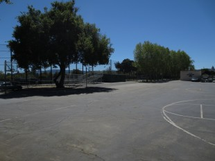 The basketball hoops outside the gym are going to be converted into parking lots due to increased demand. [Photo: Amanda Carlsson]