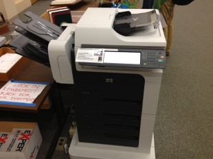 The library bought two new printers to replace its old one.