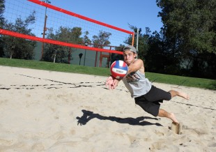 Junior Josh Totte makes a dive while competing in Palo Alto High School's own coed volleyball club. Photo by Scotty Bara.