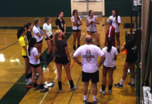 The Palo Alto High School girls Volleyball team huddles up in the Big Gym before practice. The Vikings are preparing for their first home game versus the Castilleja Alligators. They hope to have a strong season.