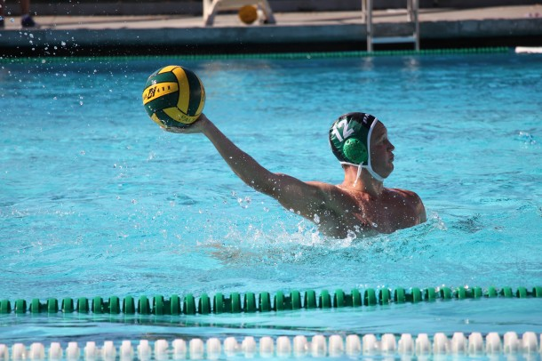 Senior Ethan Look passes the ball in the boys' water polo team's first league game. The Paly boys lost to Gunn High school 7-14. Photo by Julianna Heron.