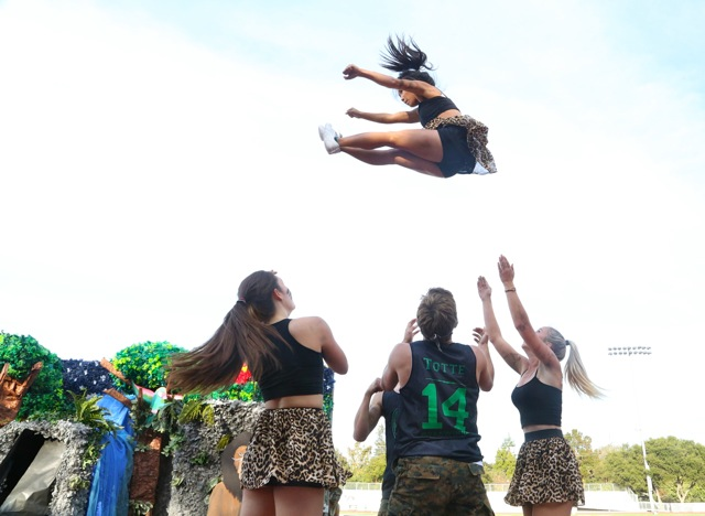 Performers pull off a stunt in last years spirit dance competition. This year, the routines will take place on the football field and will have no maximum number of participants per grade. Photo by Cathy Rong.