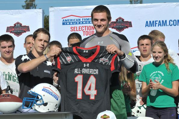Senior quarterback Keller Chryst was presented his honorary game jersey for the Under Armour All-American Game today on the football field. Chryst, the top-rated pocket-passing quarterback in nation for the Class of 2014, will be taking his talents to Stanford University next fall. Photo by Paul Bienaime