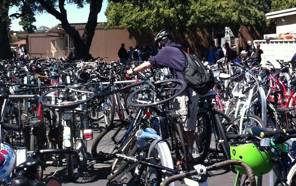 Junior Haruhiko Kuramochi struggles to remove his bike from the crowded bike racks after school. Photo by Lizzie Chun.